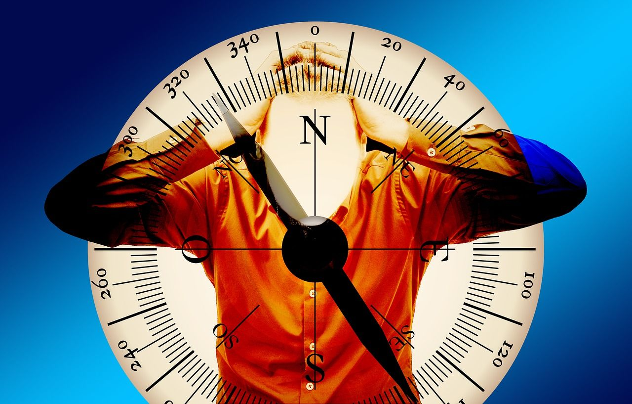 Compass and man with ADHD behind it