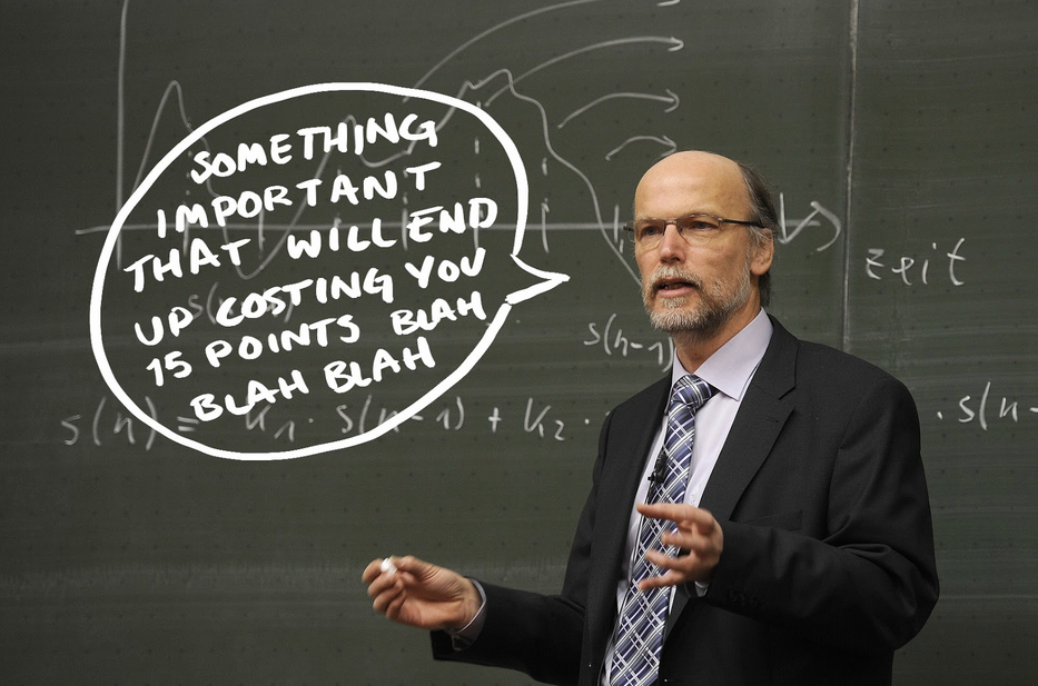 Professor in front of chalkboard saying important things before exam