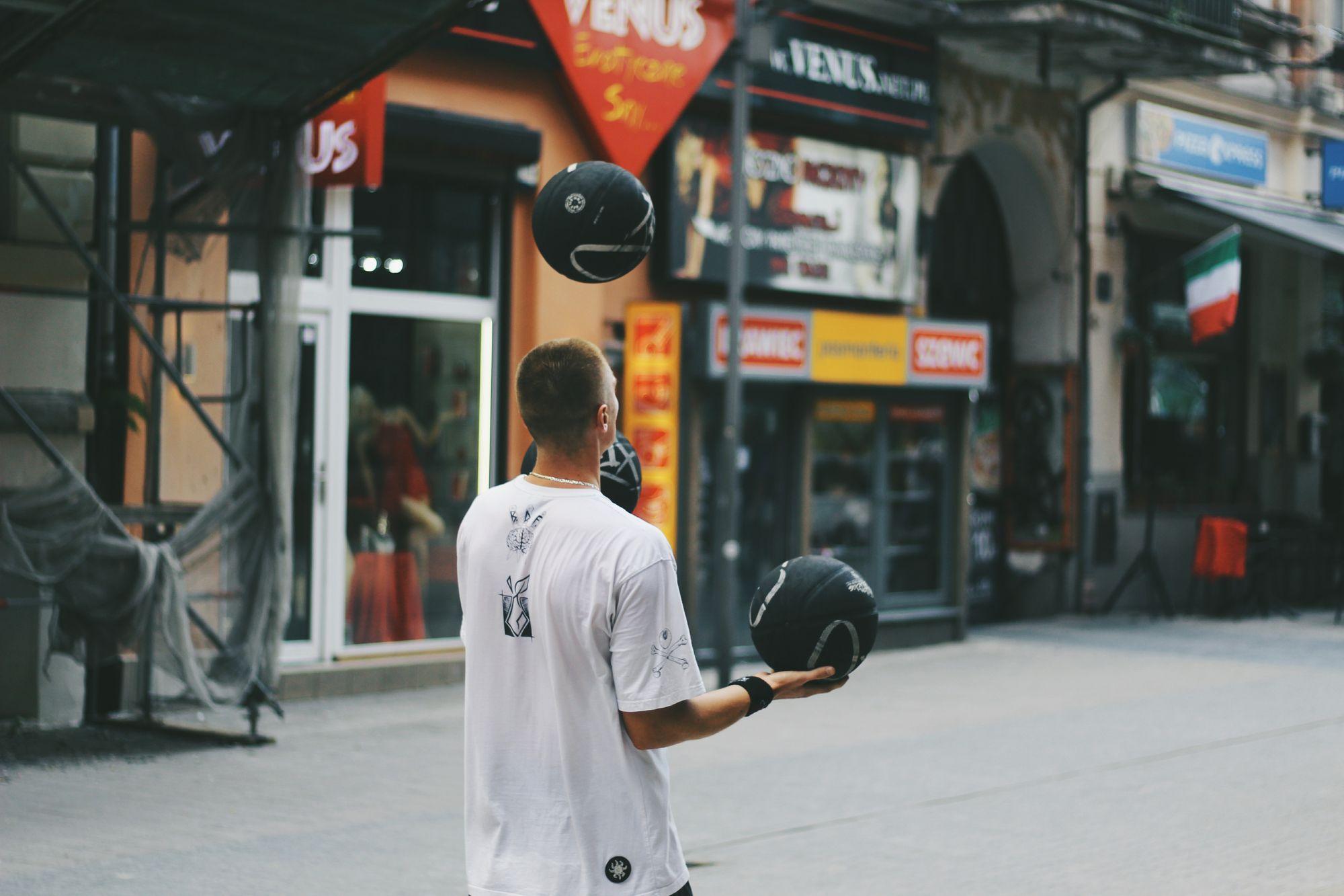 Man juggling basketballs
