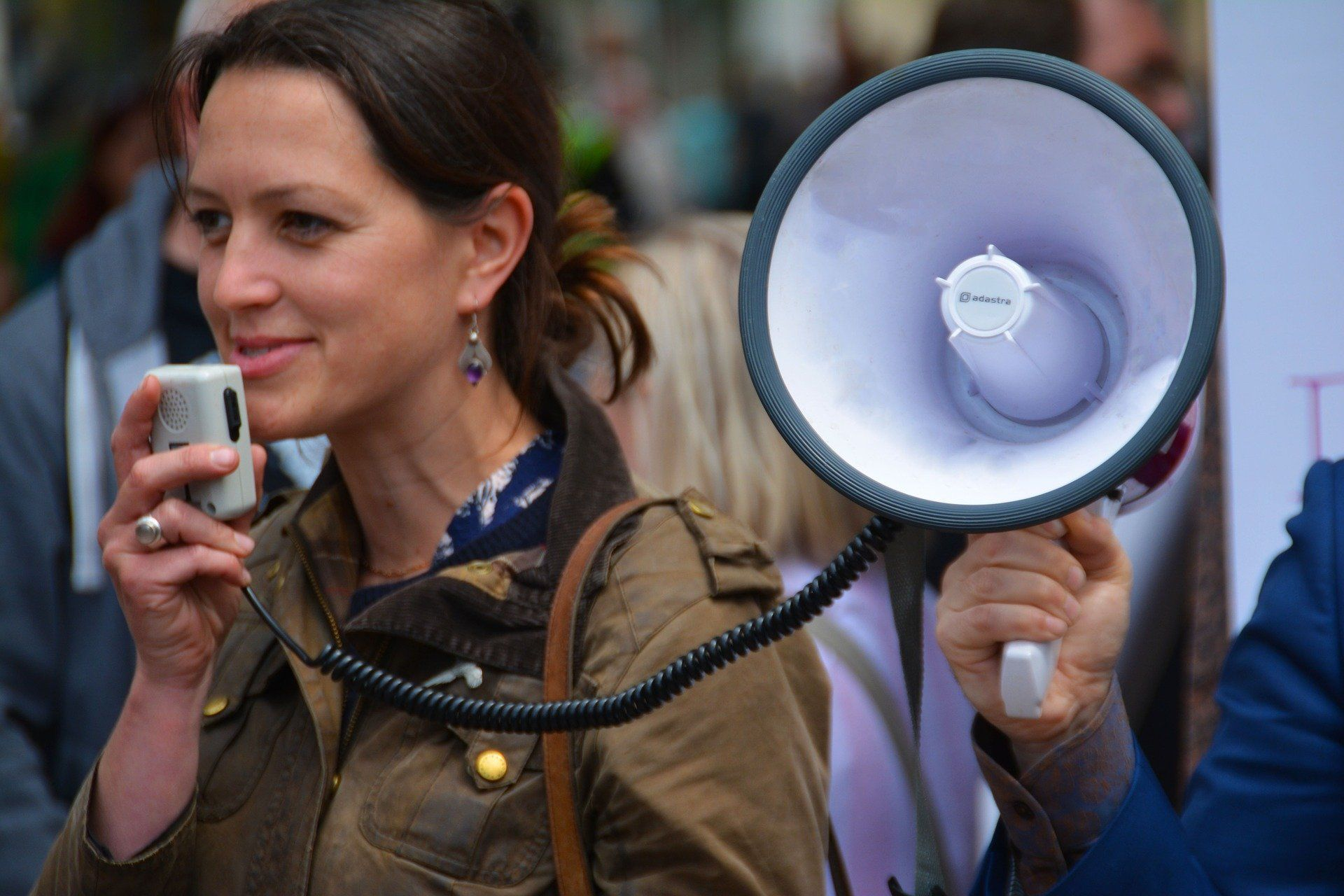 Lady with megaphone speaking