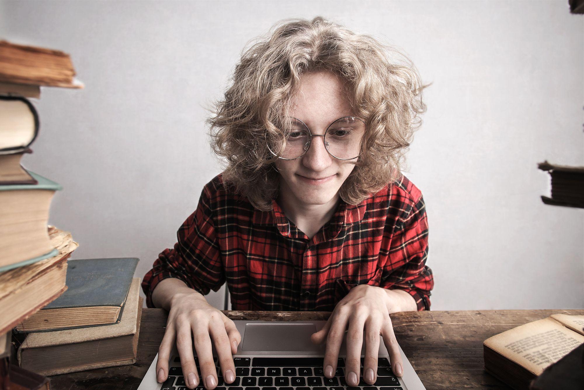 Man writing notes on his laptop