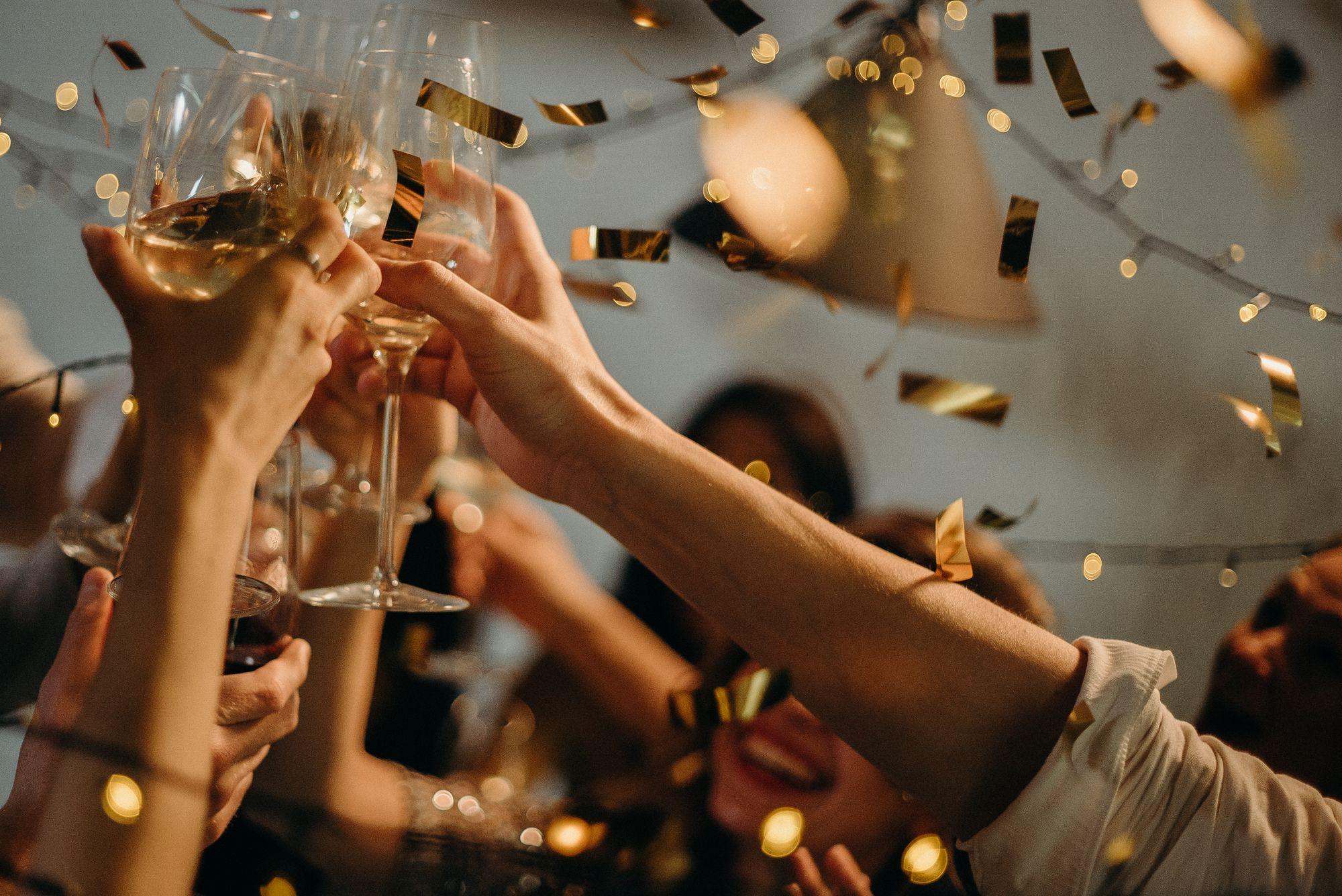 Toasting glasses in celebration