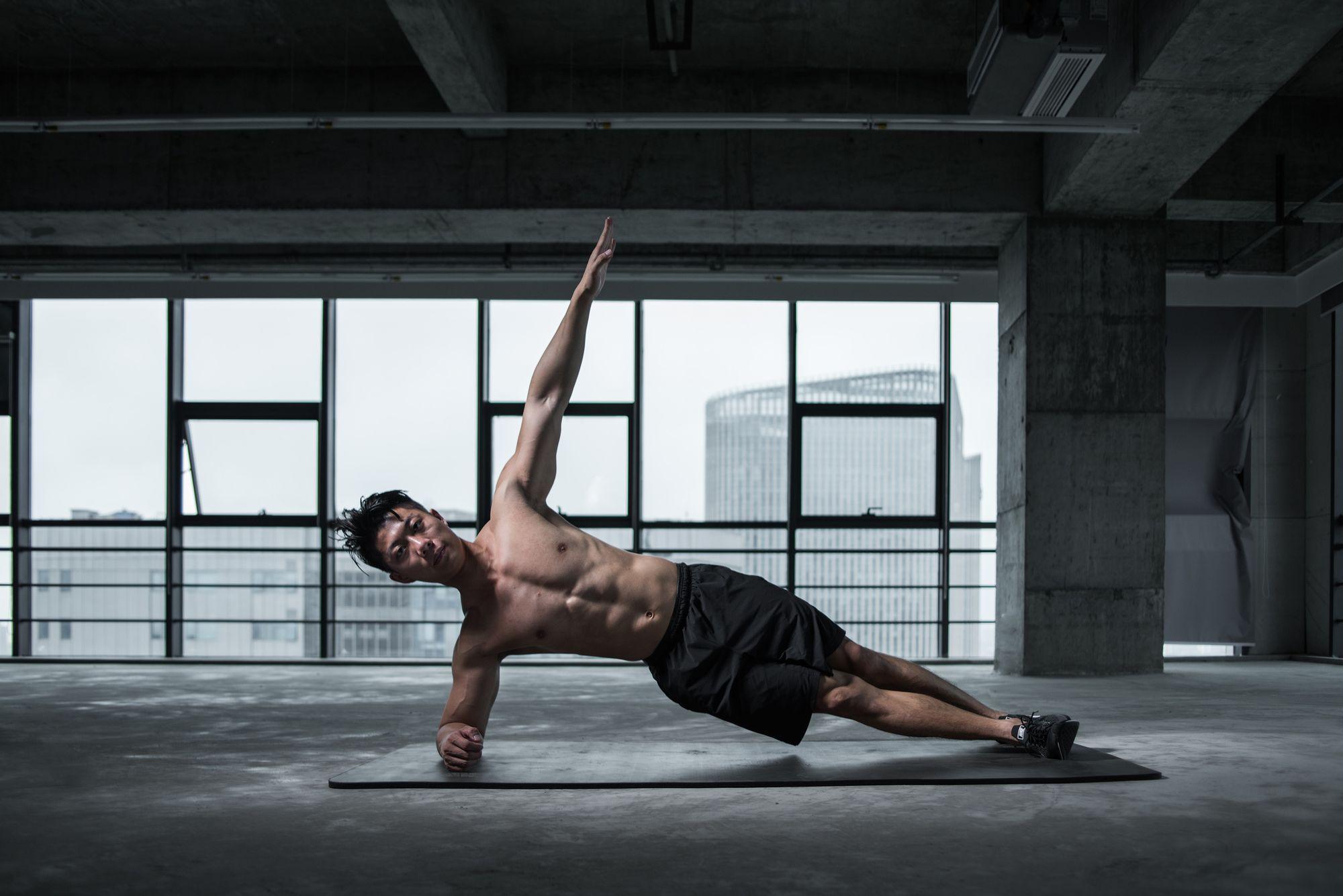 Man striking a yoga pose