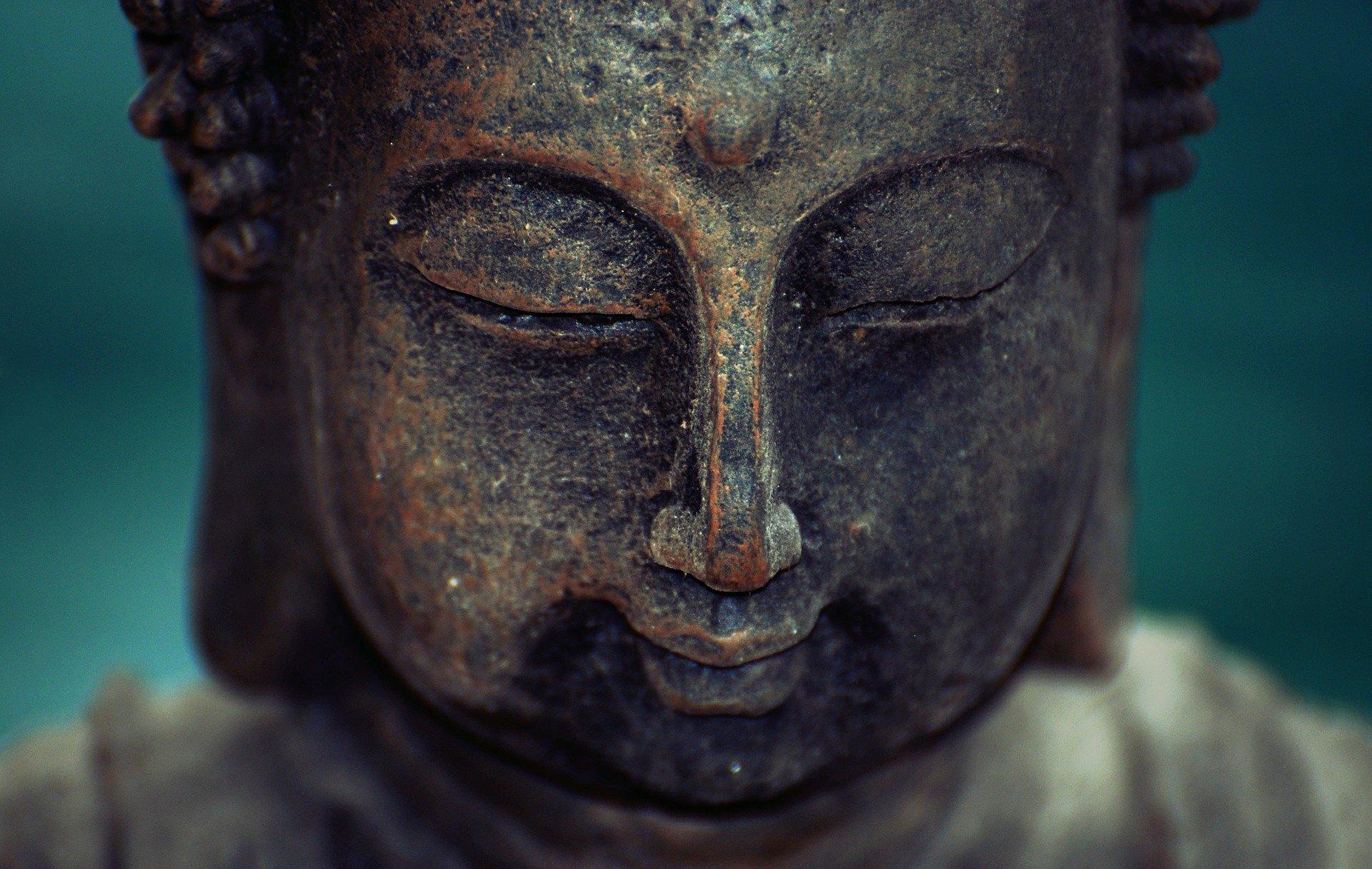 Zen copper statue