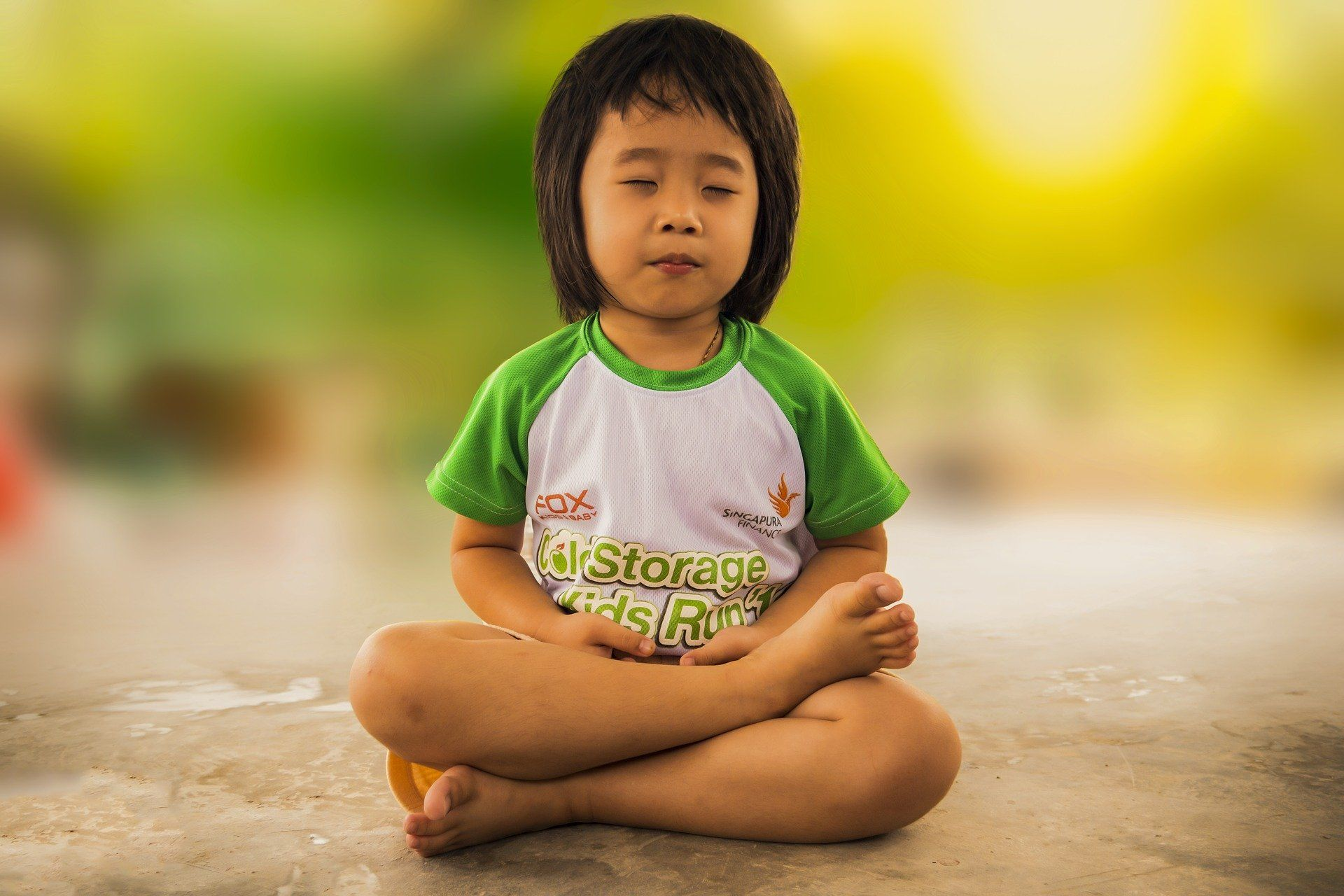 Young girl sitting and meditating