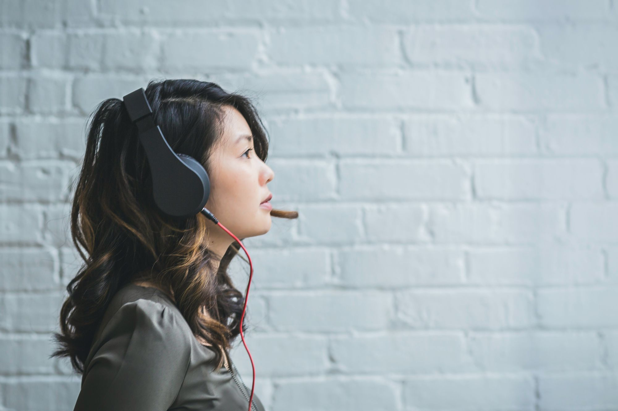 Lady listening to headphones to learn a language