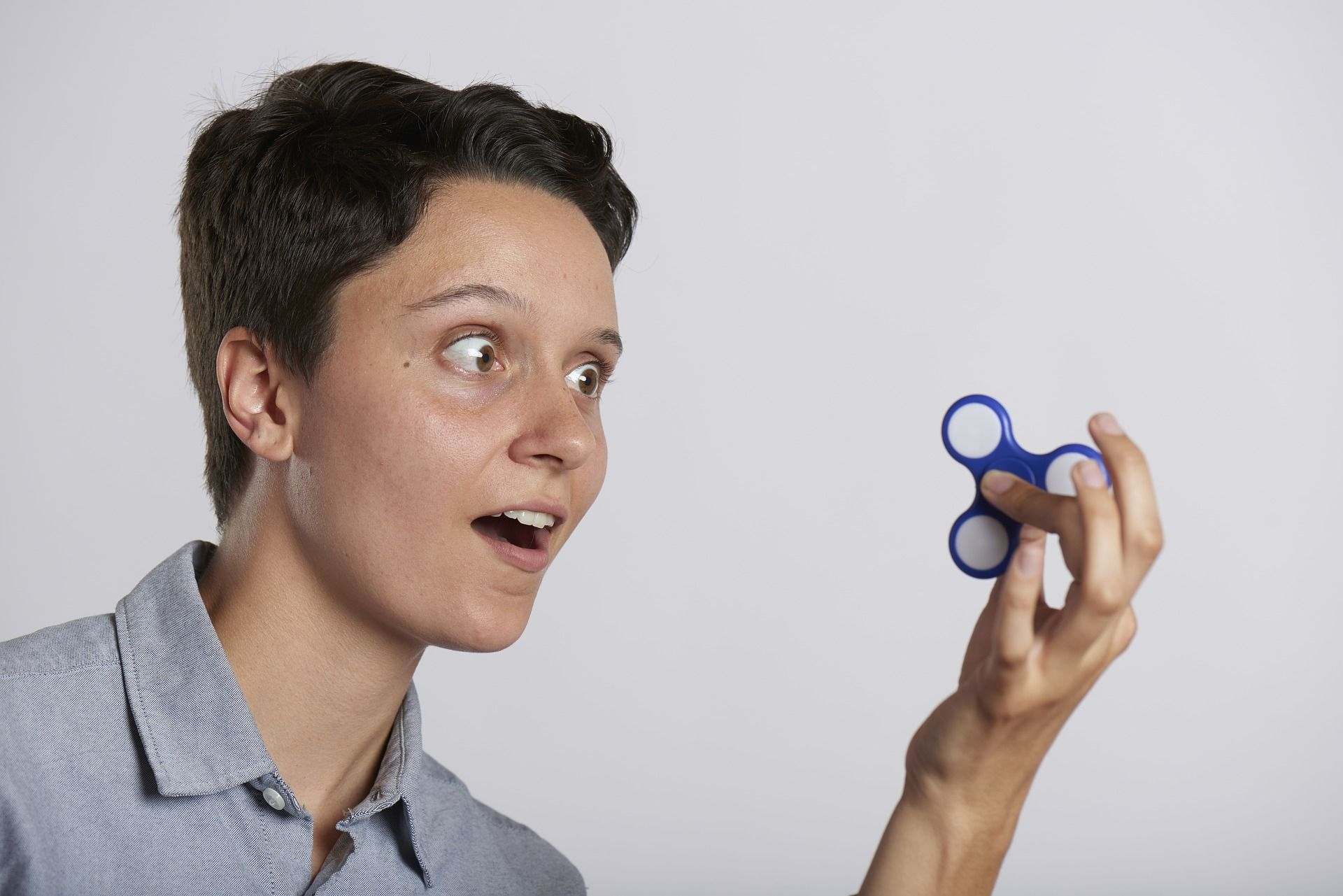 Person with fidget spinner not focused on study