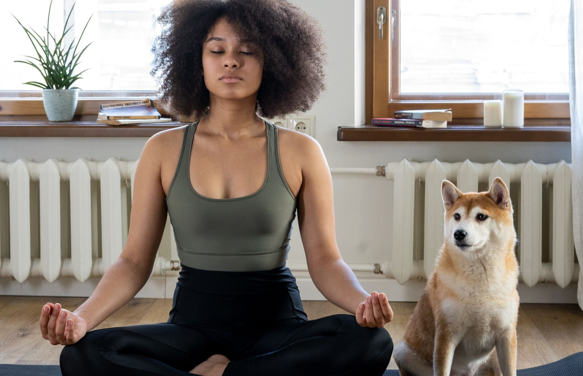 Lady with dog meditating for focus