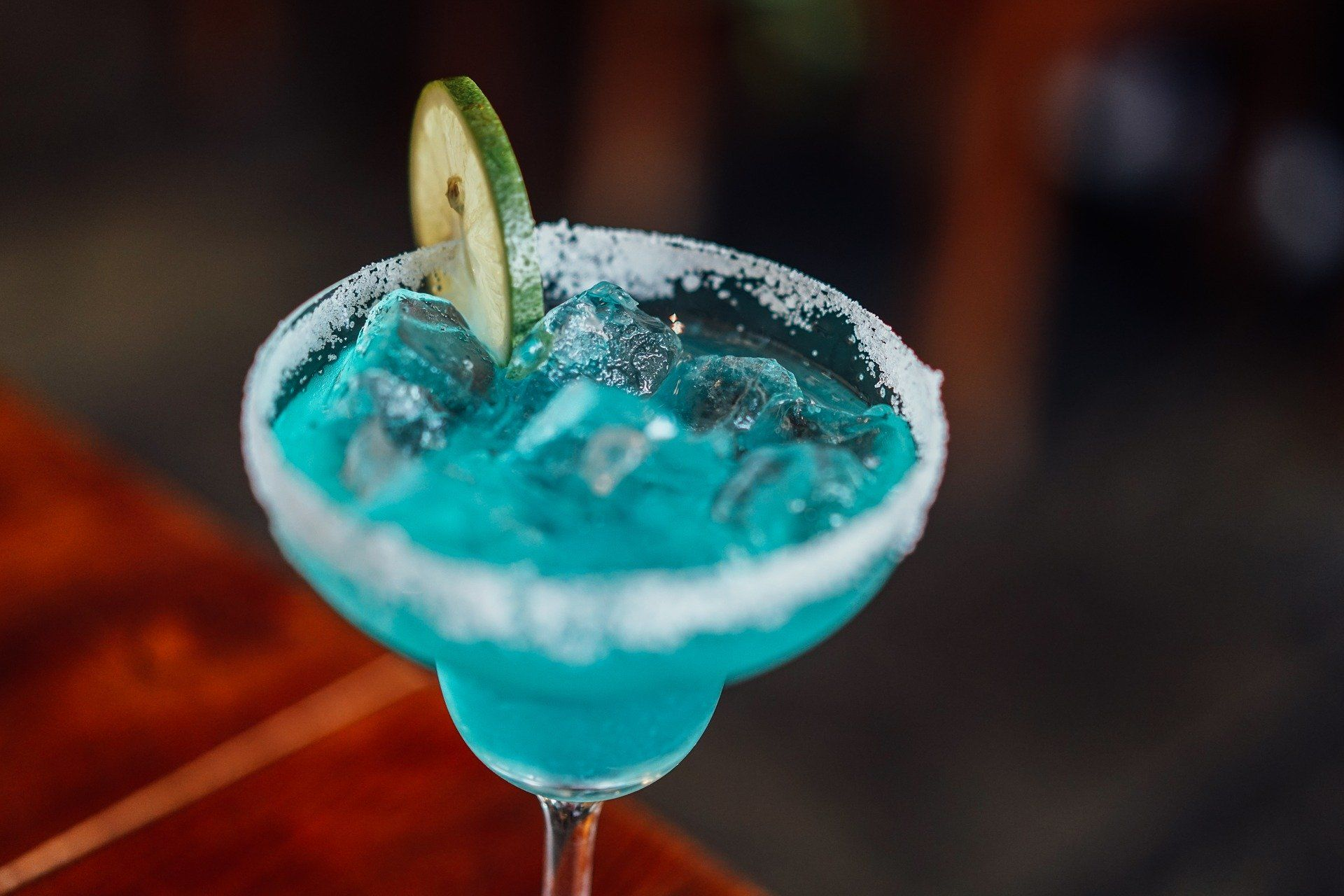 Blue cocktail with a lime wedge