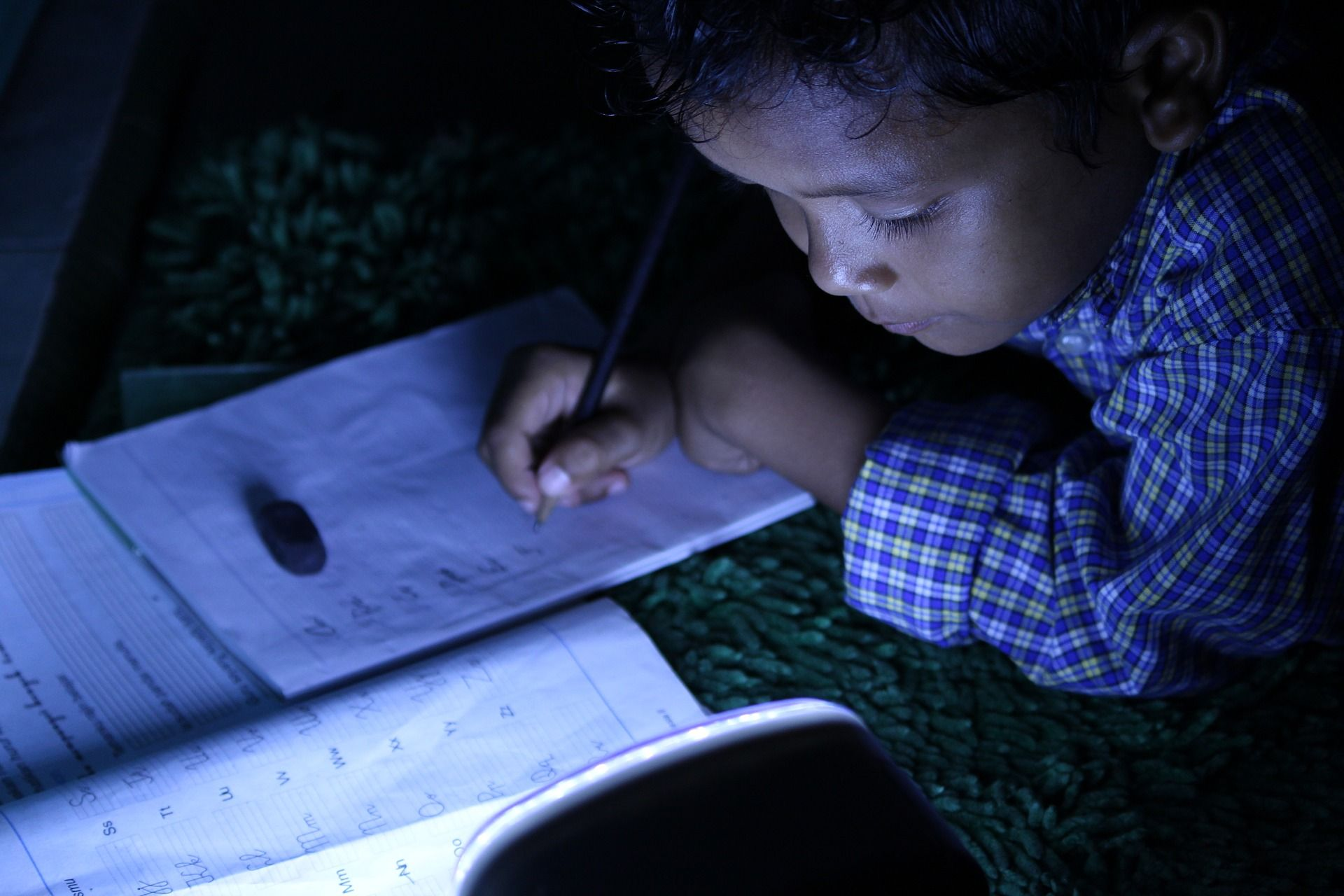 Child studying under the lights