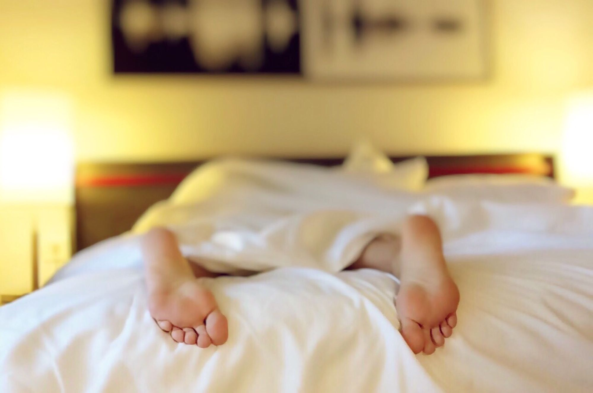 Person lying on the bed resting for brain health