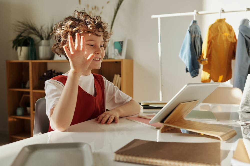 Child studying in front of laptop