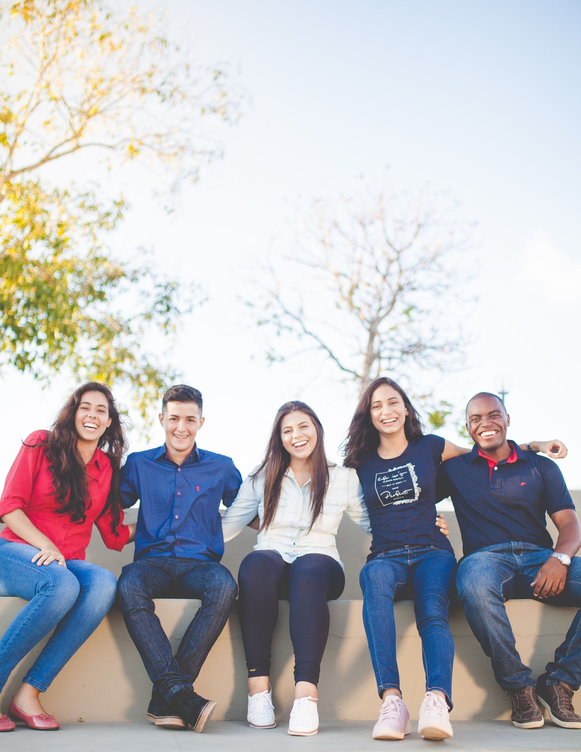 College students sitting on bench