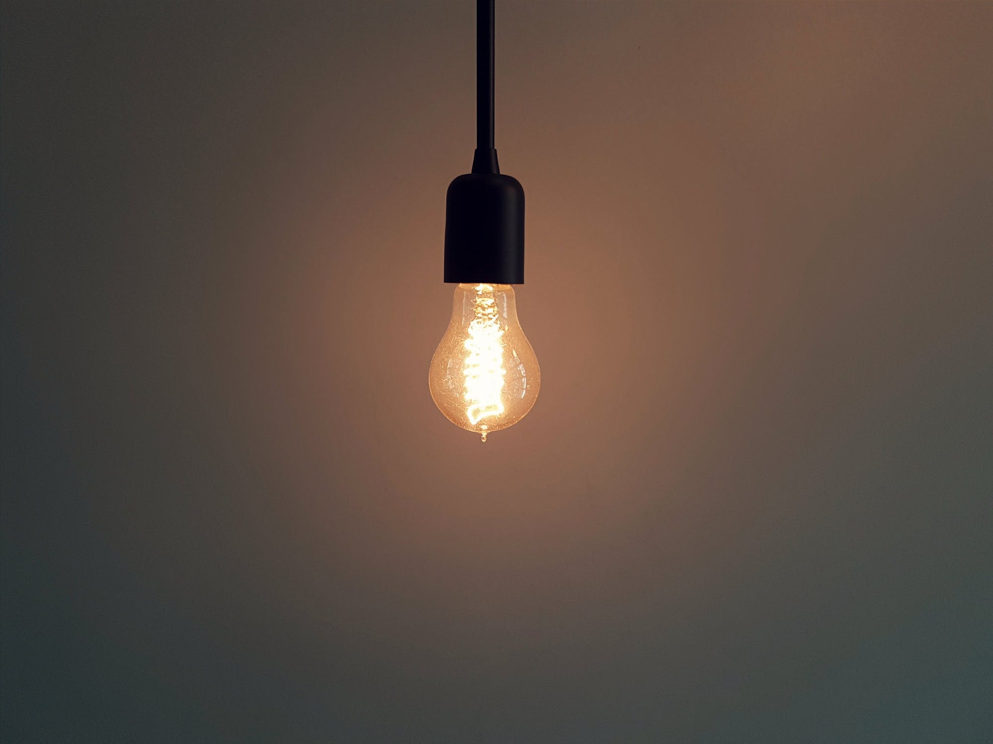 Lightbulb hanging from the ceiling.