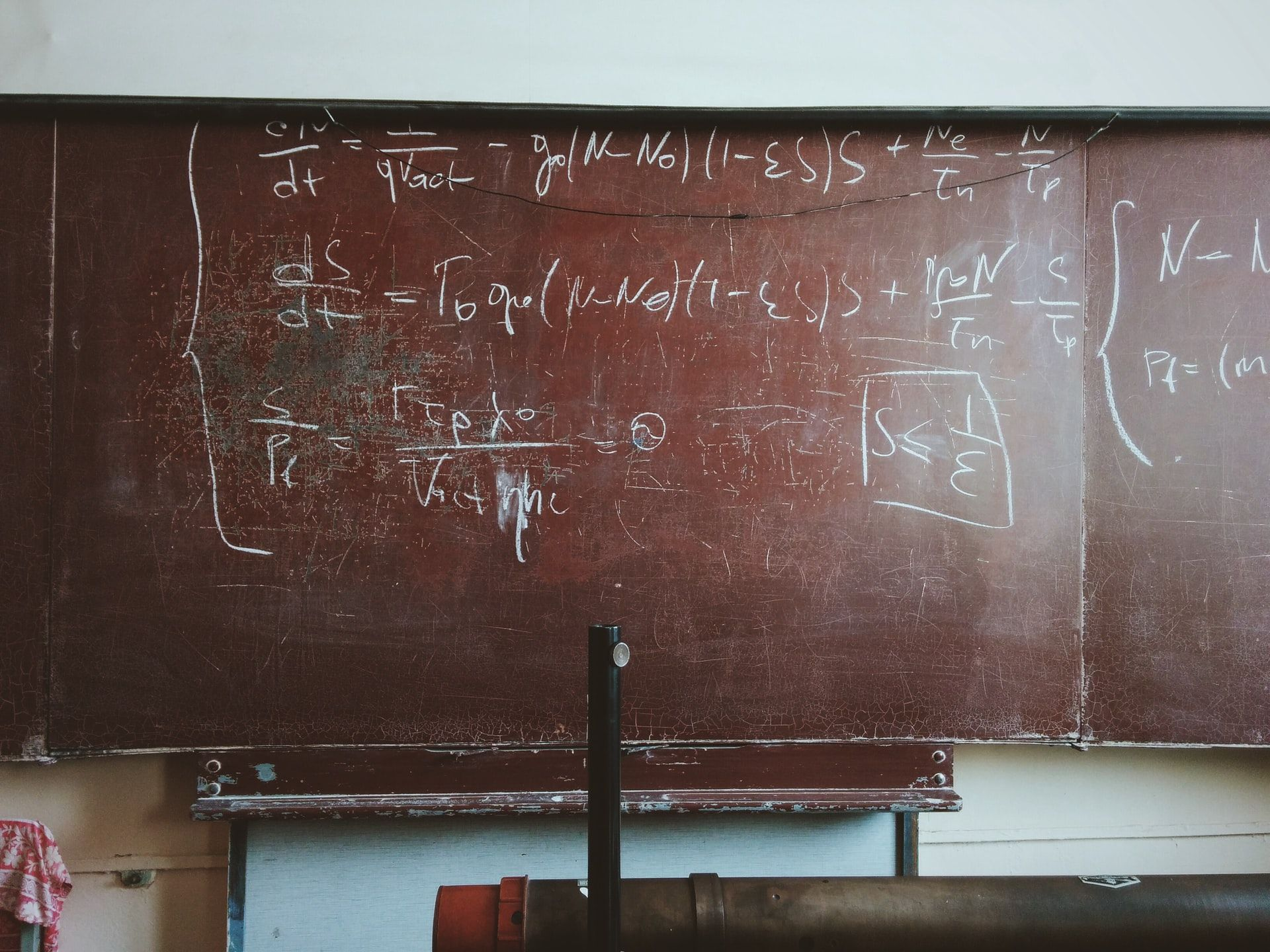 Physics concepts on a blackboard