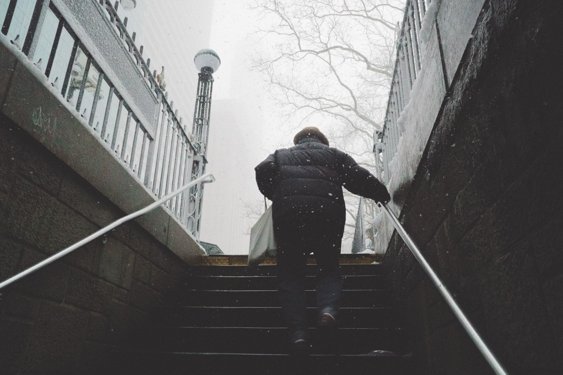 Man walking up stairs exercise without gym