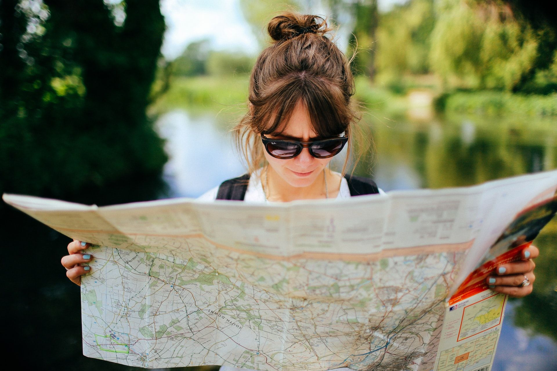 Woman looking at map, geography facts