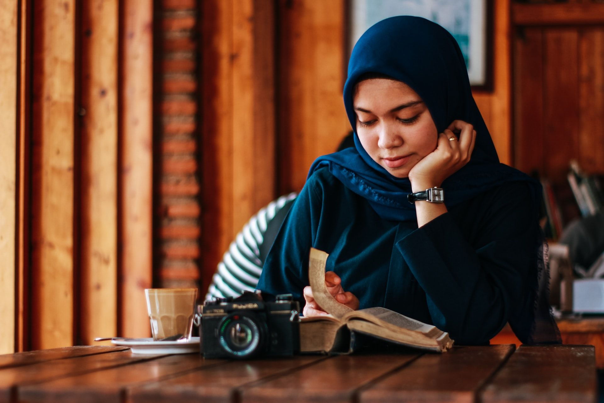 Woman with camera and book, how to read faster