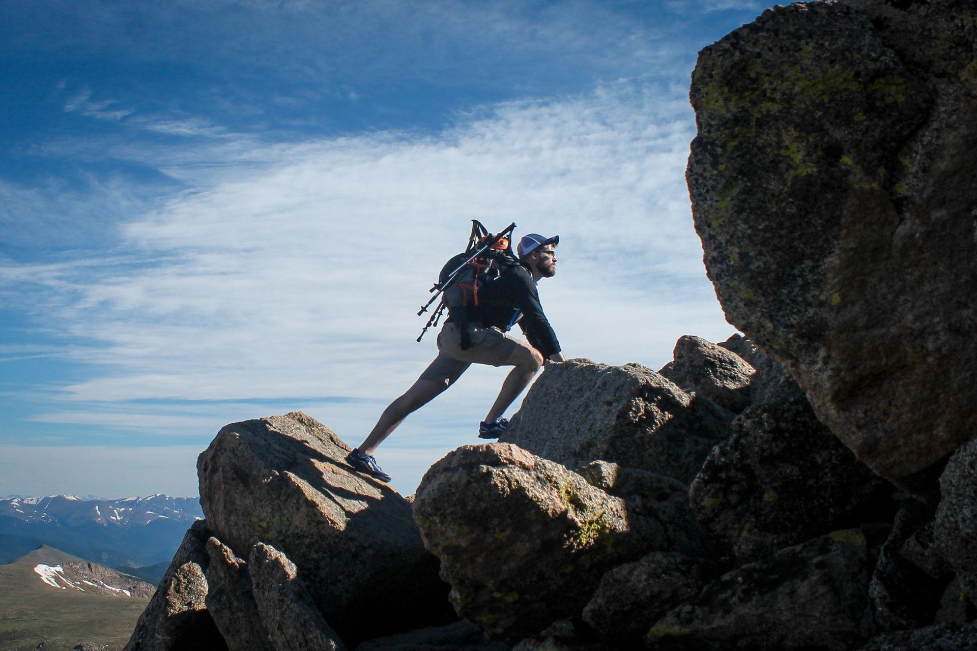 Man climbing rocks learning and development