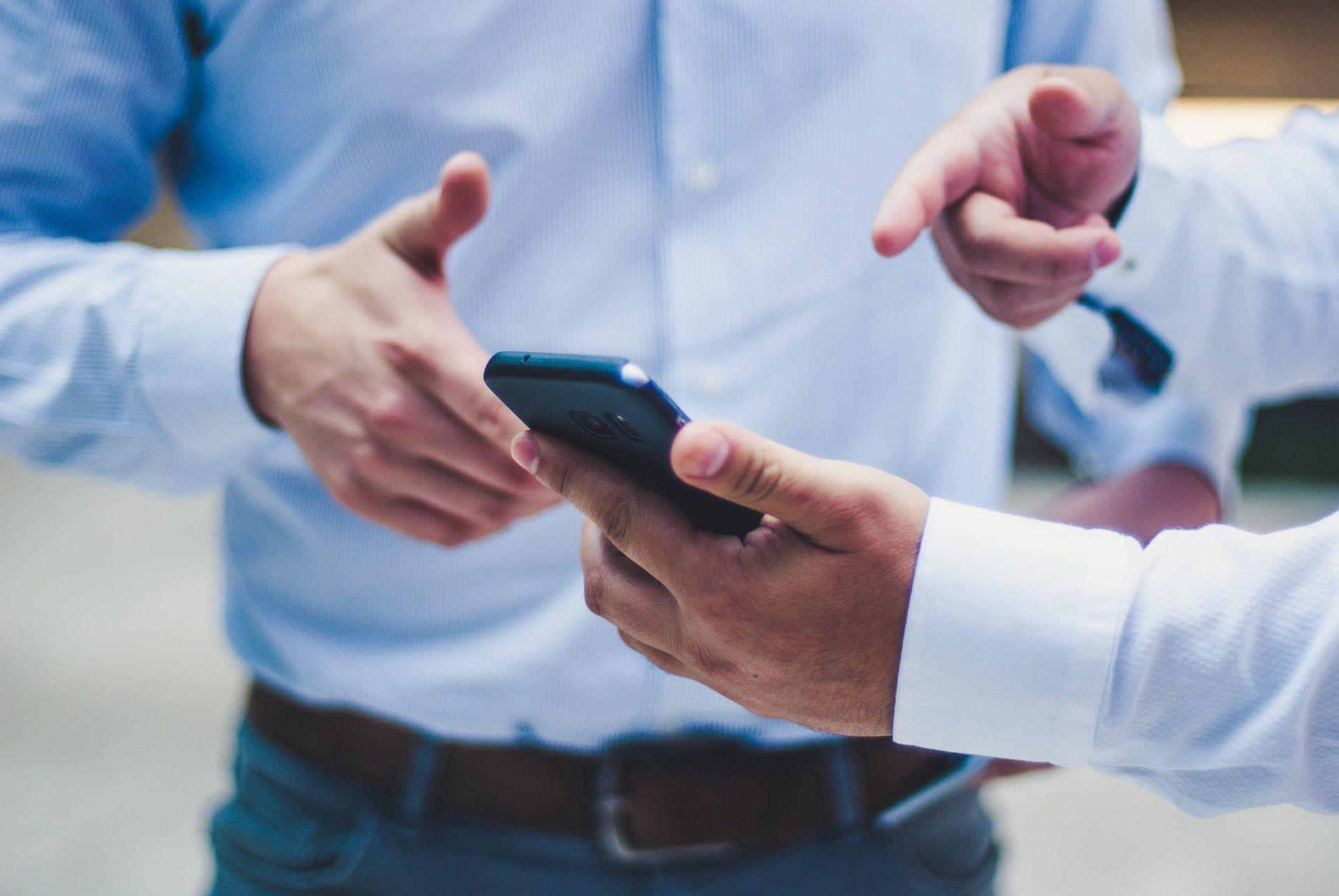 men holding mlearning mobile phone