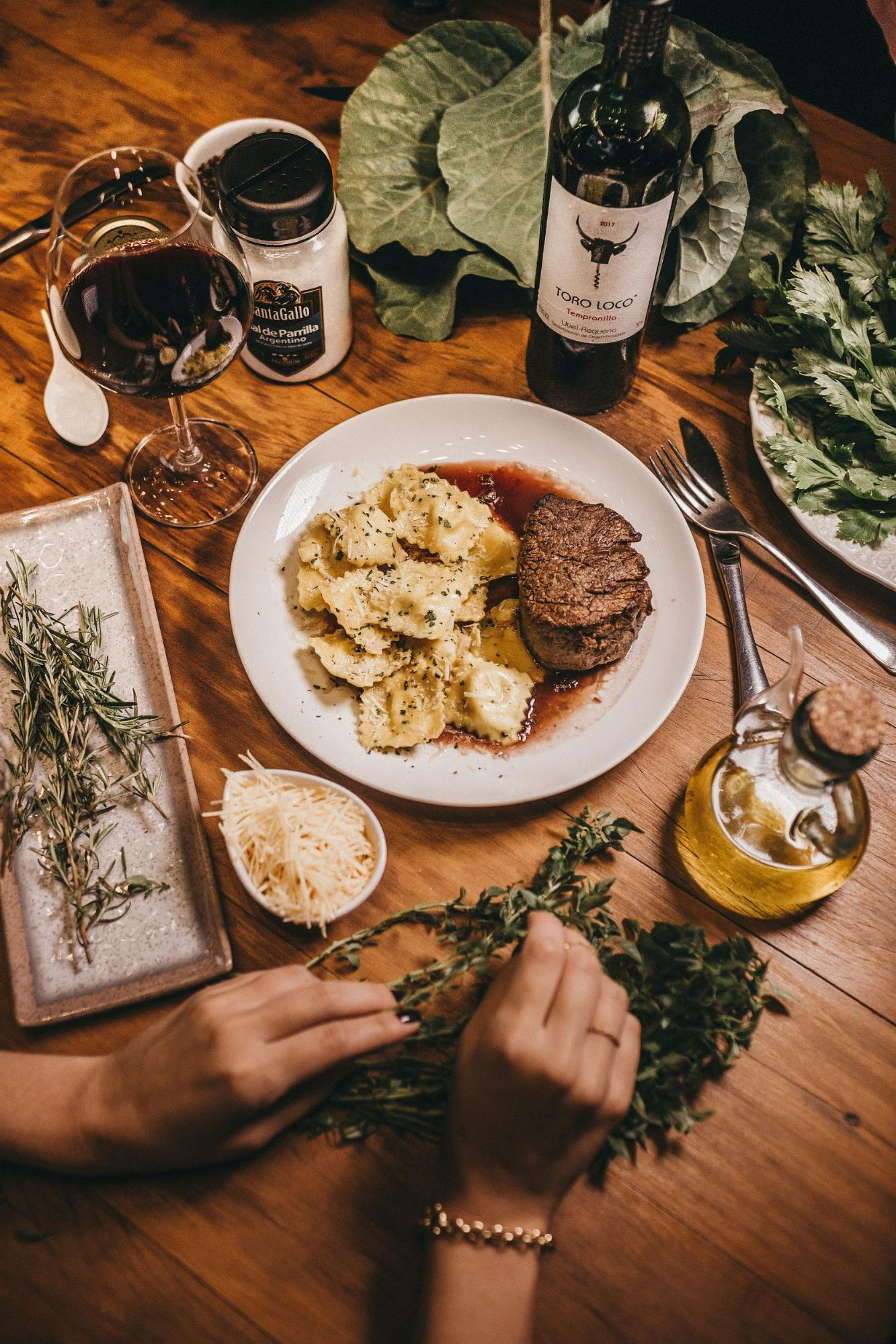 A decadent meal with pasta and red wine