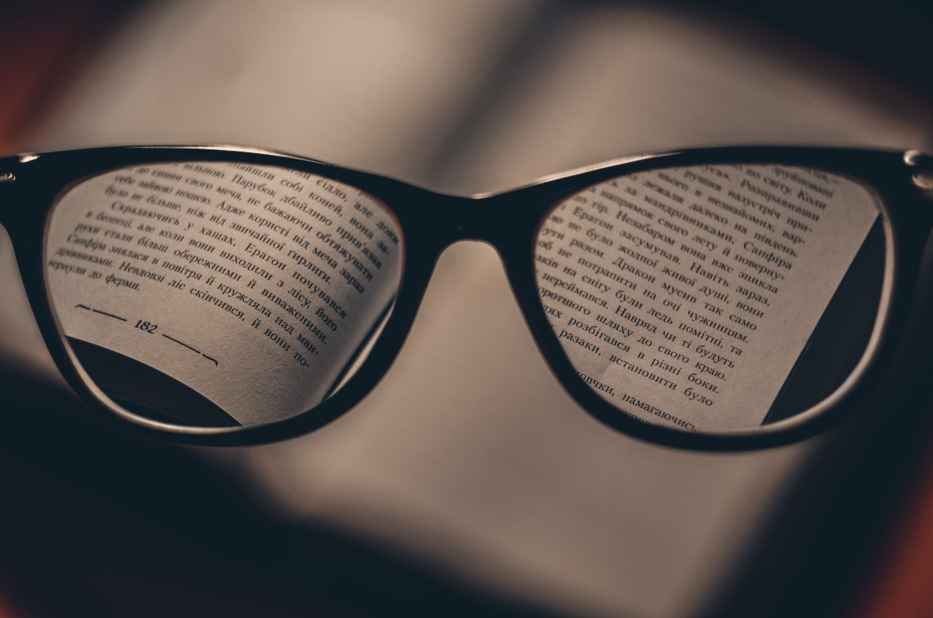 glasses and dictionary to study vocabulary