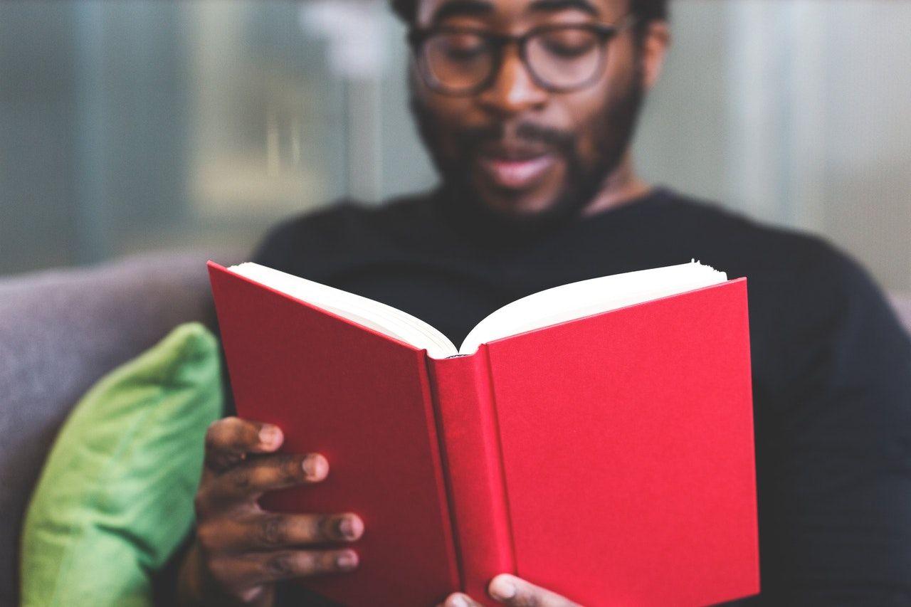 Man reading book study for bar exam