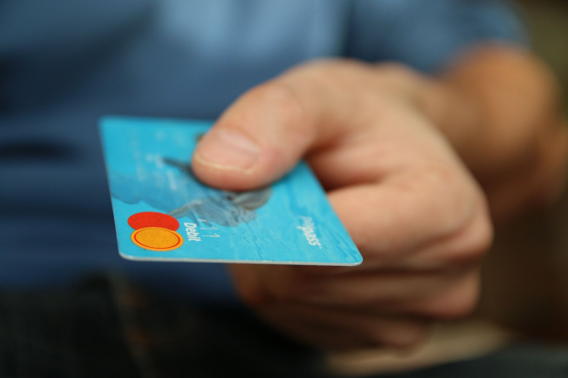 Hand with credit card for a wine sommelier