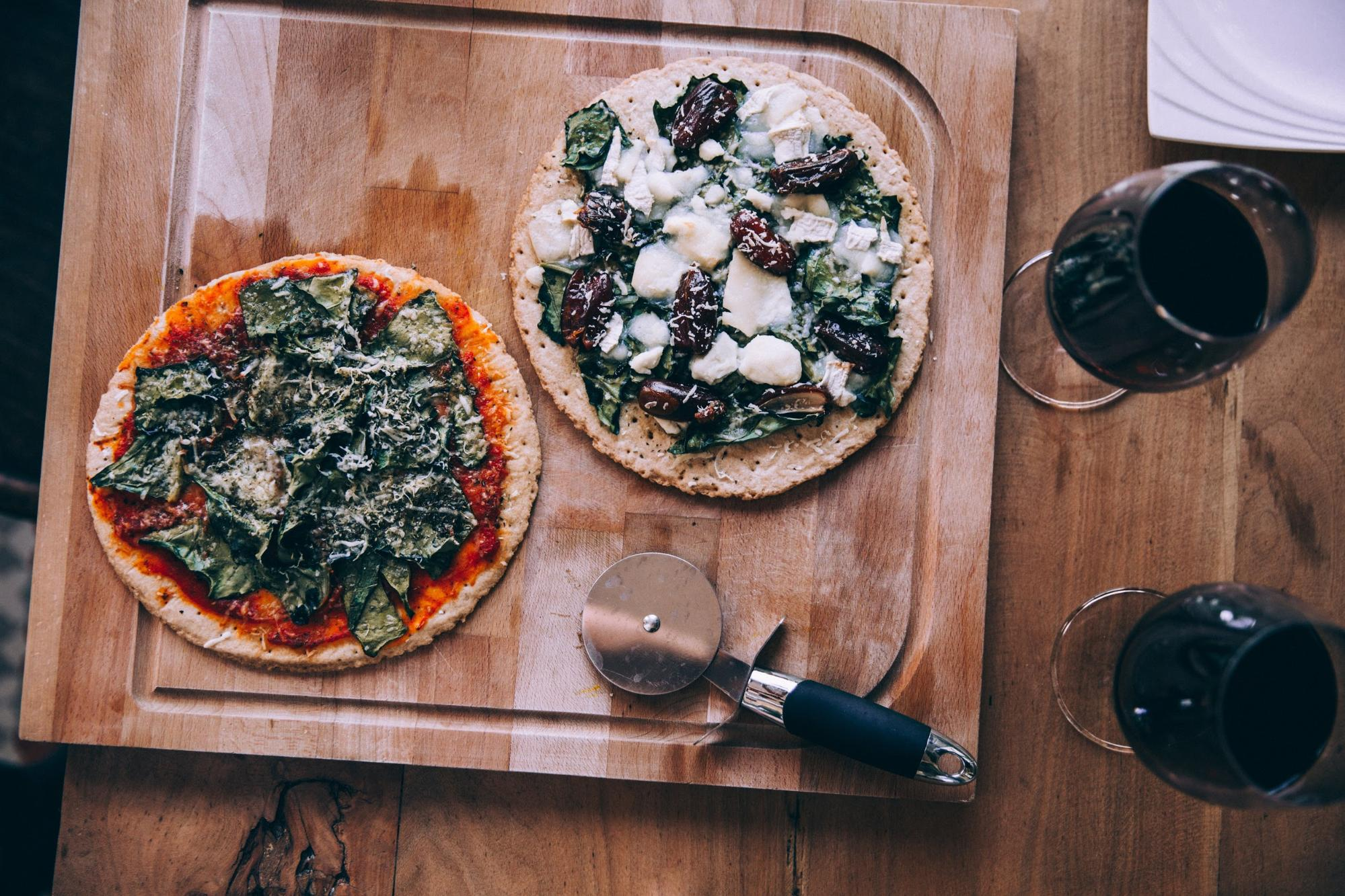 Pizza on a table; wine sommelier
