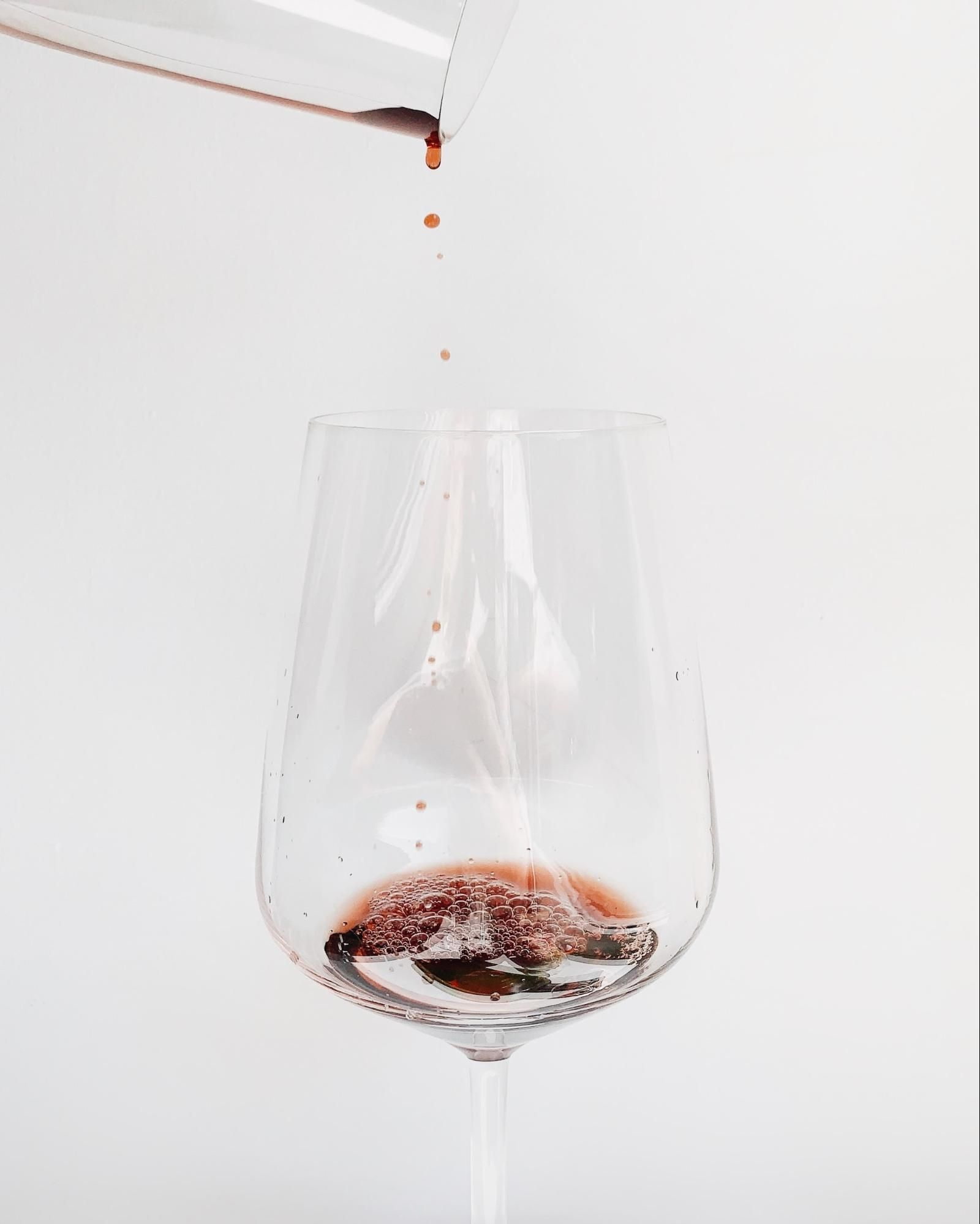 Red wine being poured into a wine glass; WSET 3
