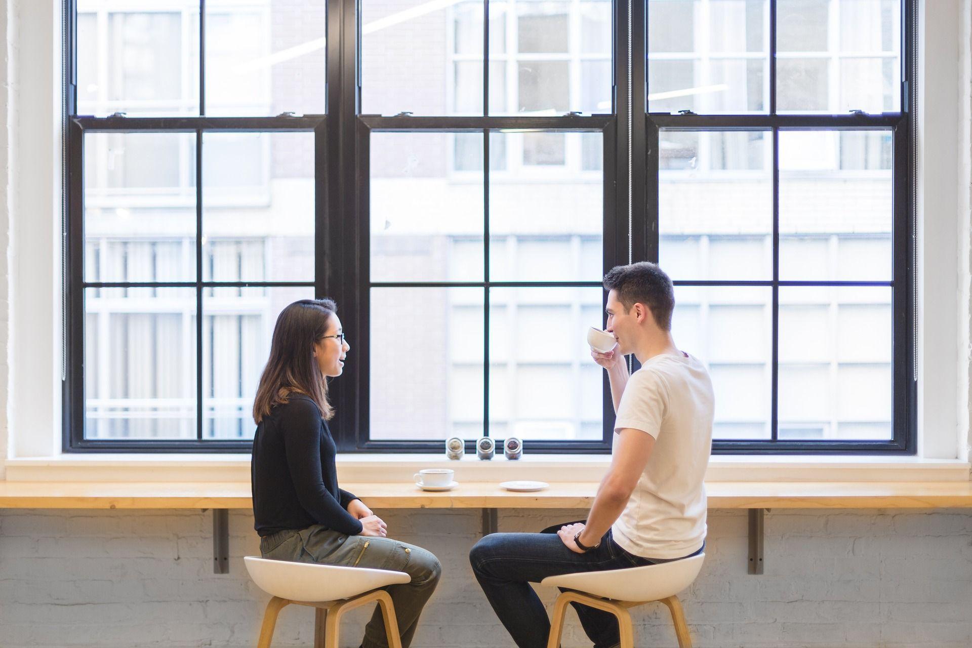 Two people having coffee; NCLEX study plan