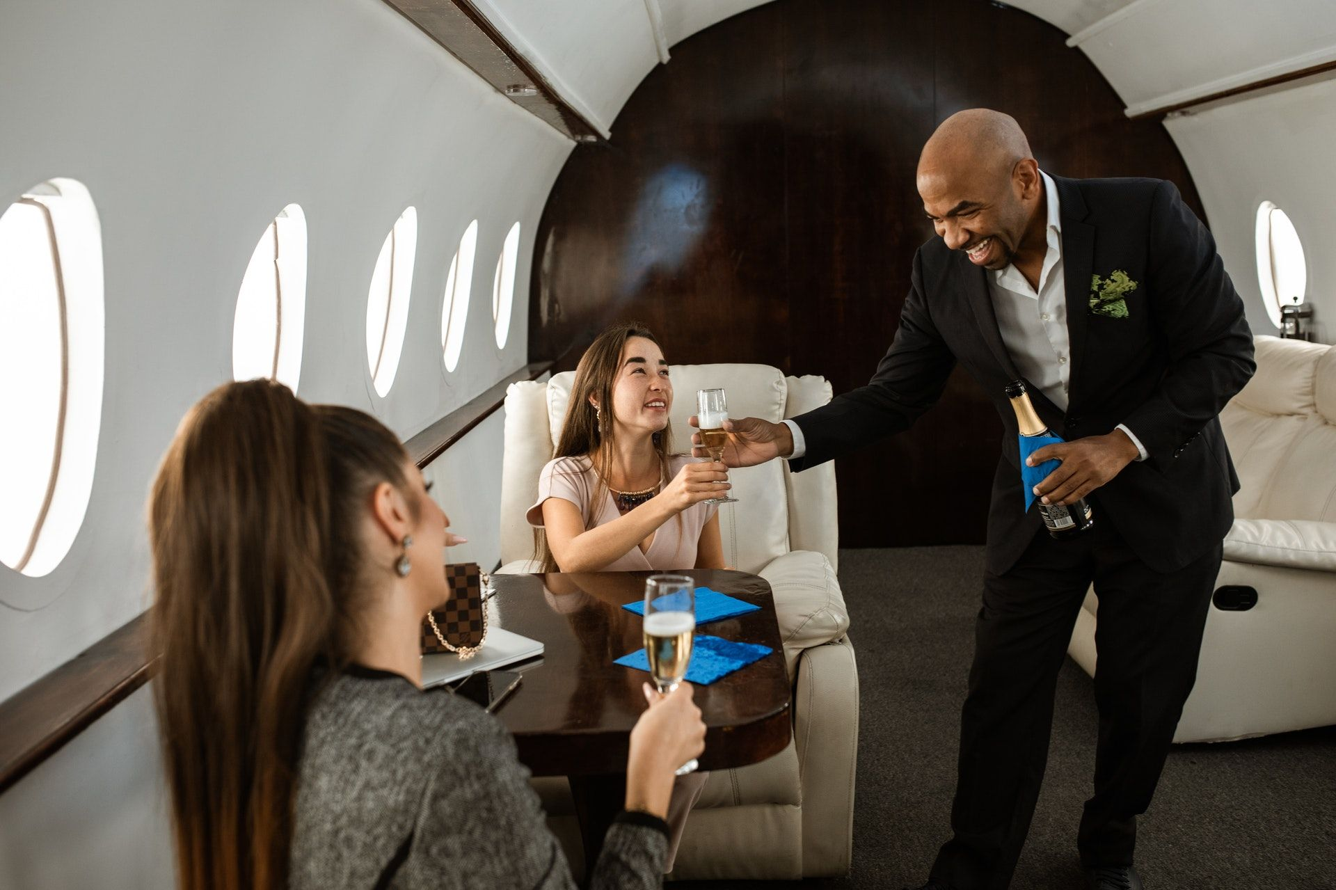 Women getting served wine in a plane; WSET Level 1 exam