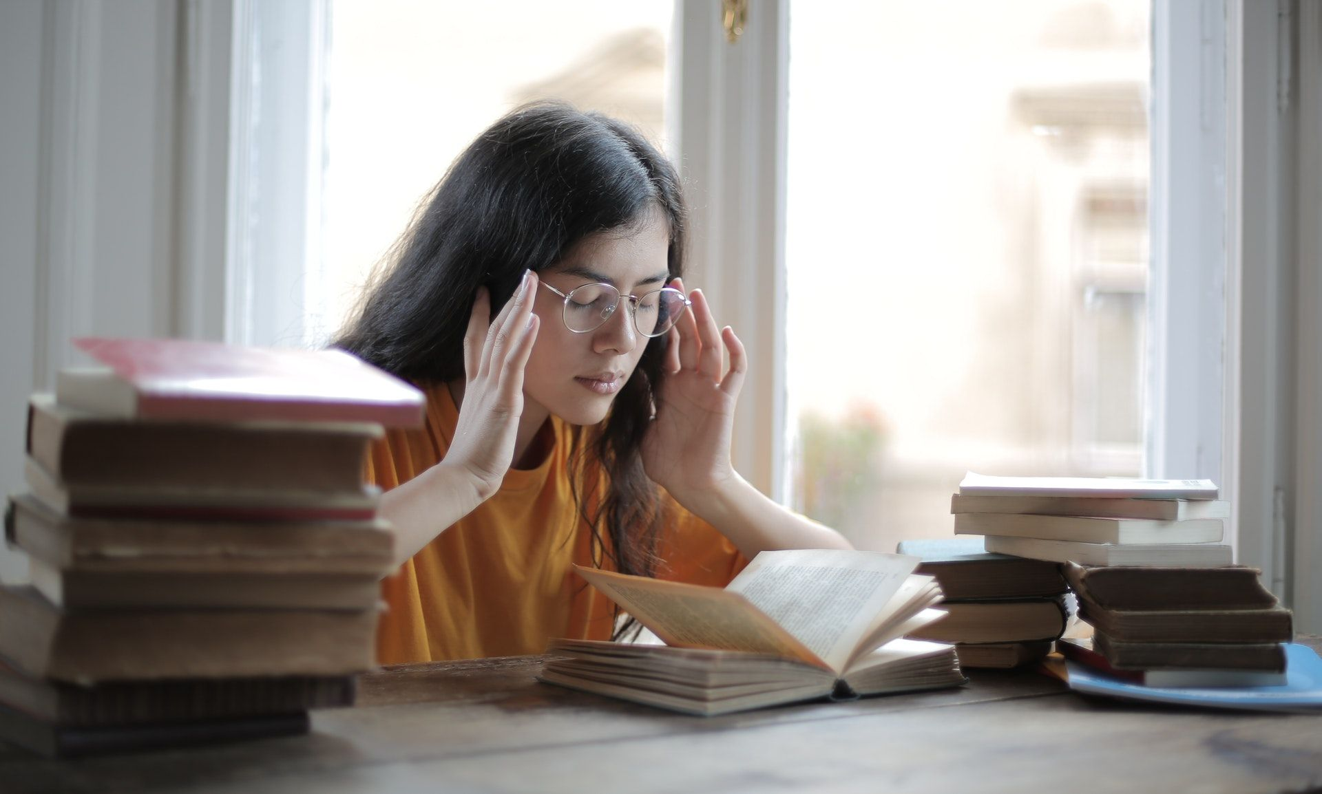 Girl studying for the Select all that apply NCLEX questions